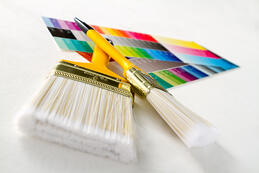 Paint brushes with color guide - isolated over white