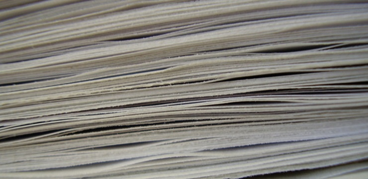Why is paper still used for invoice processing today?